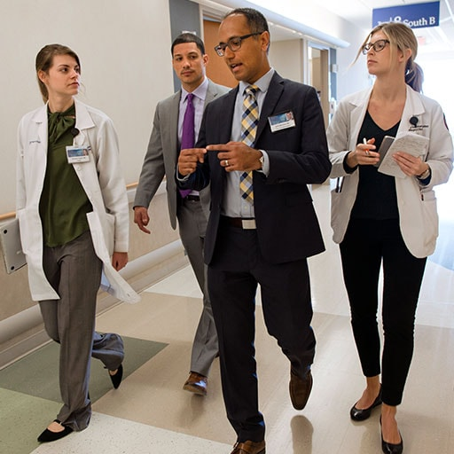 Mayo Clinic residents and faculty member on hospital rounds