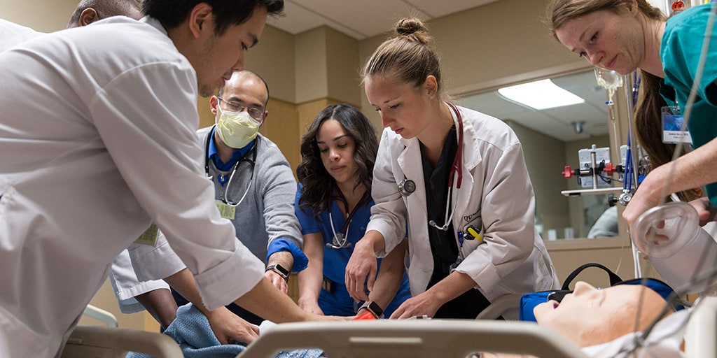 Mayo Clinic residents engaging in interprofessional education