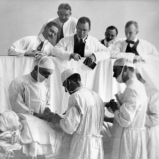 Historical photo of visiting surgeons observing at Mayo Clinic