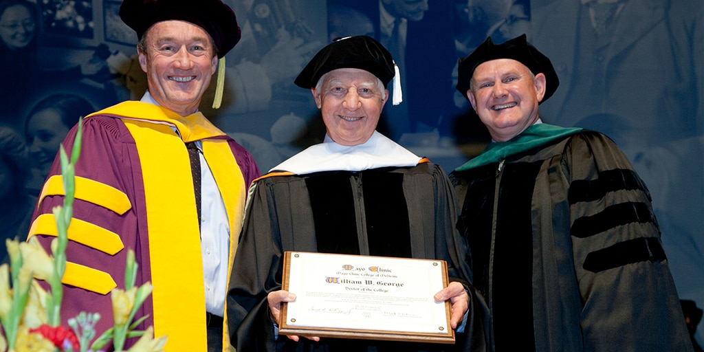 John H. Noseworthy, M.D., William (Bill) W. George, and Mark A. Warner, M.D. at 2014 Mayo Clinic College of Medicine and Science commencement ceremony
