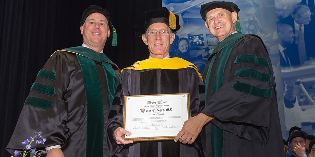 Wyatt W. Decker, M.D., Peter C. Agre, M.D., and Mark A. Warner, M.D. at 2015 Mayo Clinic College of Medicine and Science commencement ceremony