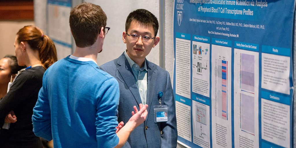 Mayo Clinic Ph.D. Program students talking at a scientific poster session
