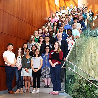 Group of students and faculty as part of M.D.-Ph.D. Program on staircase during their annual retreat