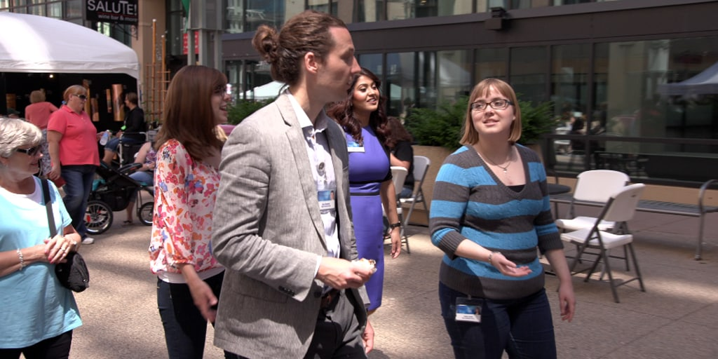 Mayo Clinic graduate students walk together down the street.