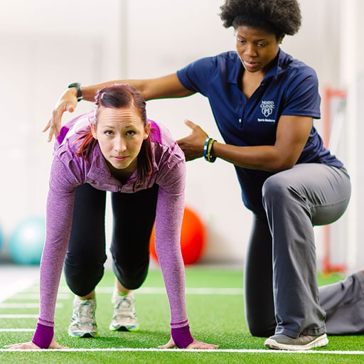 Mayo Clinic athletic trainer working with a sprinter