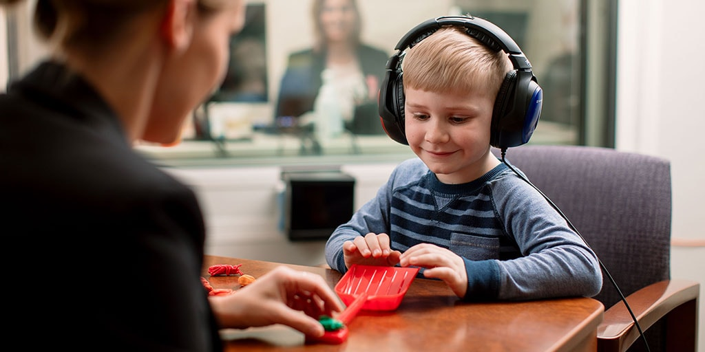 Mayo Clinic audiologist conducting a hearing test on a child