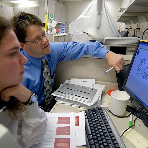 Mayo Clinic cytogenetic technologists working on a computer
