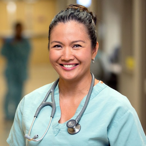 Mayo Clinic nurse smiling in a hospital hallway