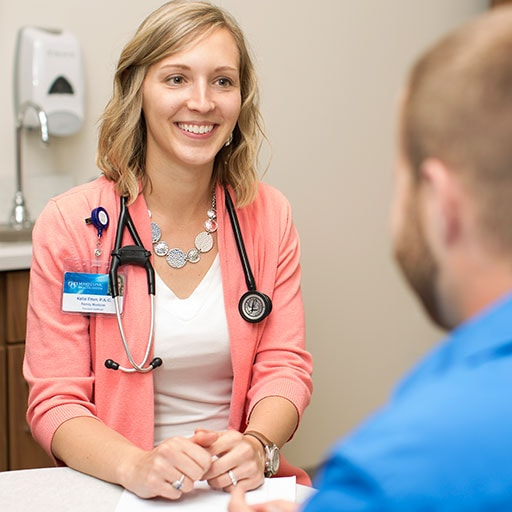 Mayo Clinic physician assistant listening to a patient