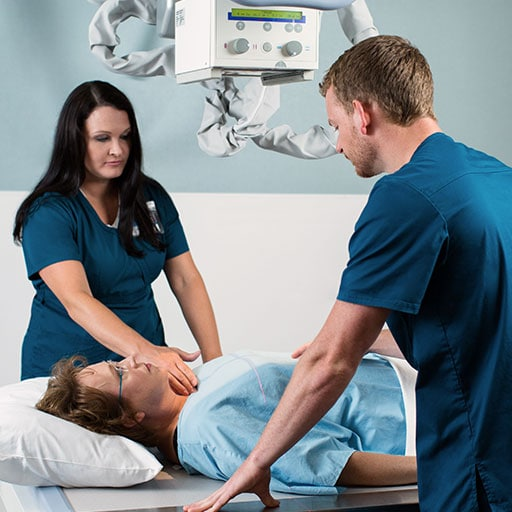 Mayo Clinic radiographers performing a scan on a patient