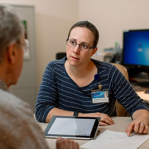 Mayo Clinic medical speech language pathologist listening to a patient