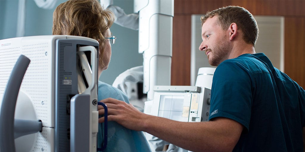 Mayo Clinic radiography student performing a scan on a patient