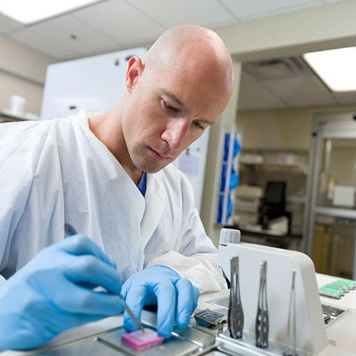 Histology technician working with tissue sample