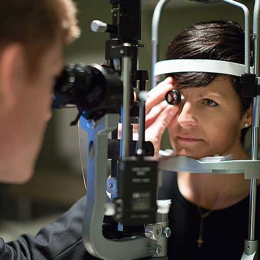 Glaucoma fellow works with a patient at Mayo Clinic in Rochester, Minnesota.