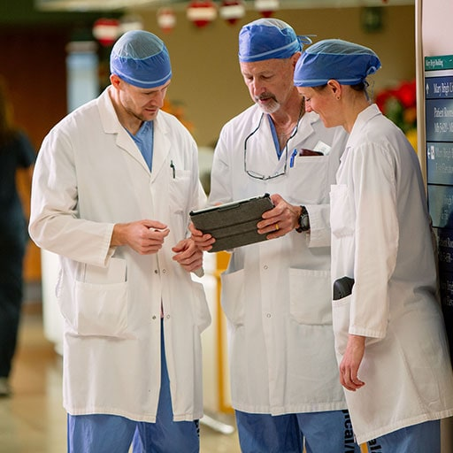 Mayo Clinic orthopedic surgeons reviewing a patient case in the hospital