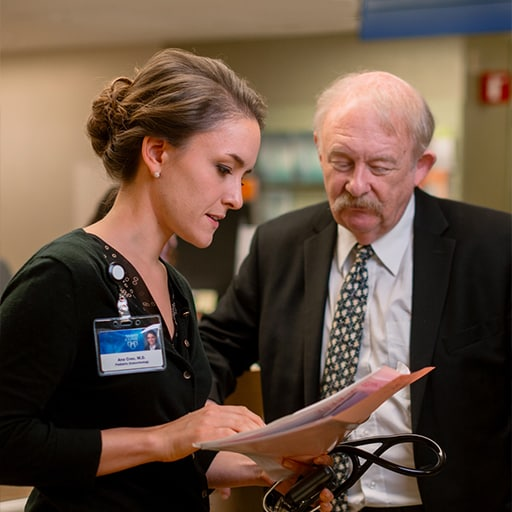 Fellow Ana Creo, M.D., consults with Dr. Schwenk