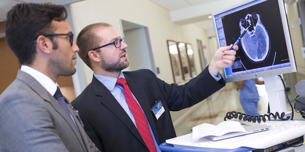 Mayo Clinic neurology residents review a brain imaging scan