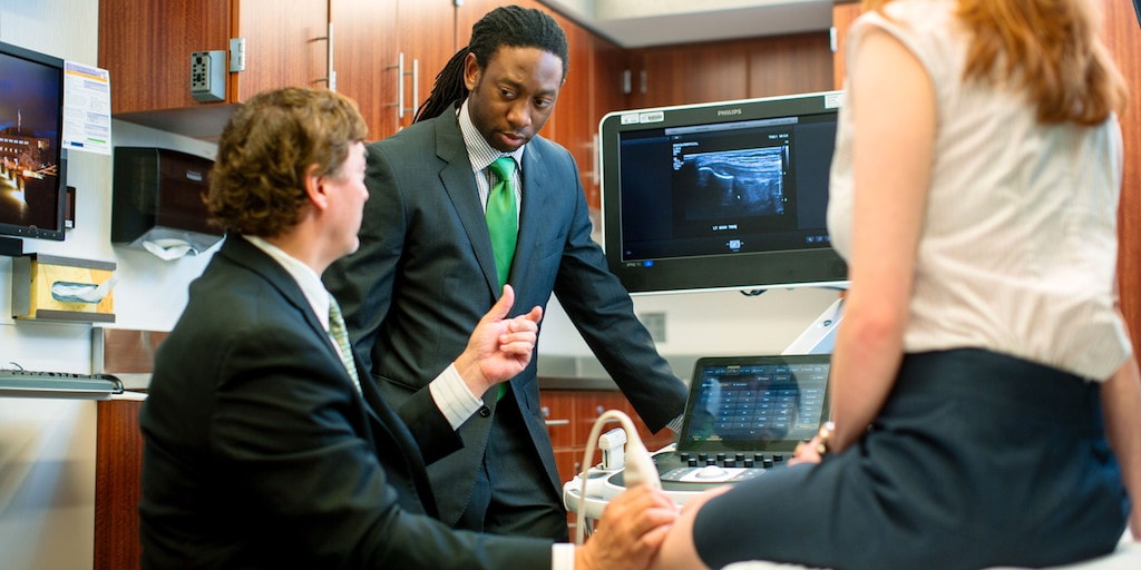 Mayo Clinic physical medicine and rehabilitation (PM&R) resident conducting an ultrasound with a faculty member