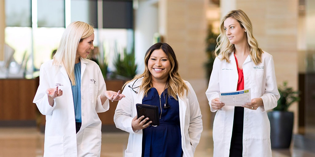 Mayo Clinic trainees talking while walking in hospital