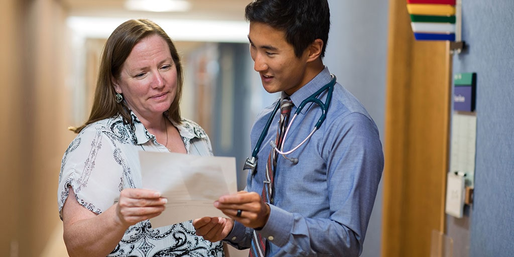 Mayo Clinic trainee reviewing patient record with colleague