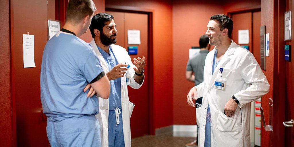 Mayo Clinic trainees talking in simulation center