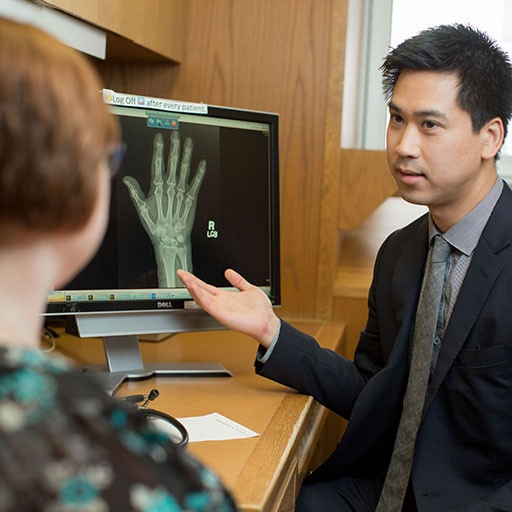 Mayo Clinic rheumatology fellow reviews results with a patient