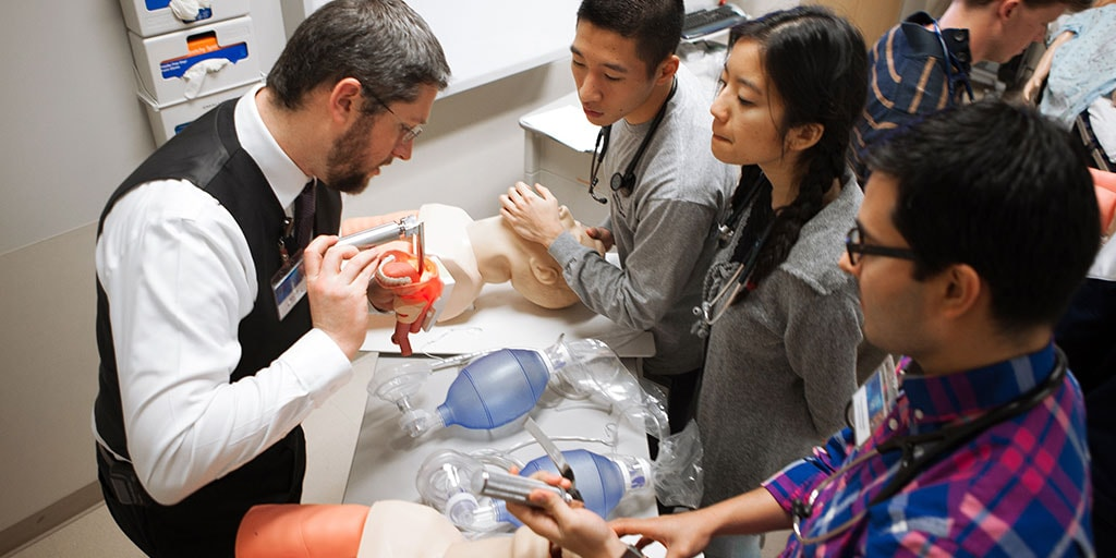 Mayo Clinic M.D. Program students learning airway technique from faculty member