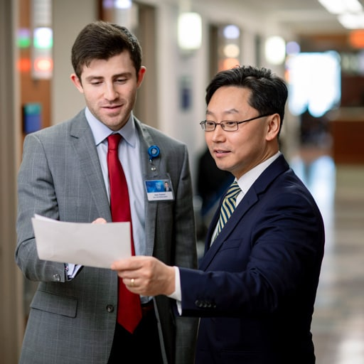 Faculty member teaching and M.D.-Ph.D. student