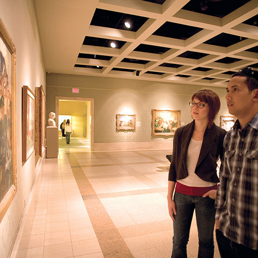 Two people looking at art exhibit at Cummer Museum in Jacksonville